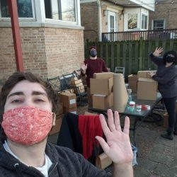 Pictured: Two friends help TESA Collective member Brian ship packages from his backyard on a particularly busy day, while remaining social distanced and masked!